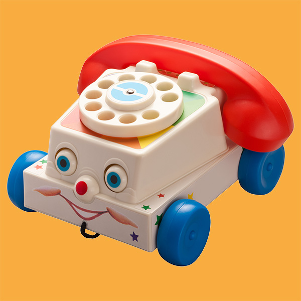 Antique Toy Phone with orange background